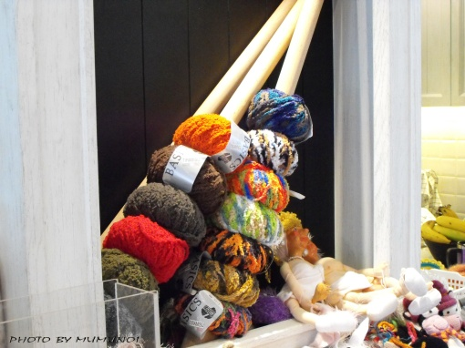 Various yarn displayed around the shop